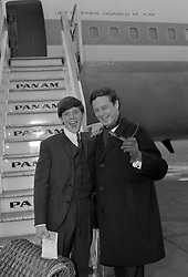 Tommy Quickly, the British engineering apprentice turned 'pop' singer, before he travelled from London Airport (Heathrow) by Pan American Jet Clipper for Los Angeles to start a two-week TV tour. His manager, Brian Epstein (r), was also flying out with him.