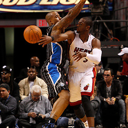 March 3, 2011; Miami, FL, USA; Miami Heat shooting guard Dwyane Wade (3) passes the ball past Orlando Magic shooting guard Quentin Richardson (5)during the second quarter at the American Airlines Arena.    Mandatory Credit: Derick E. Hingle