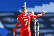 YELLOW CARD Nottingham Forest's Lewis Grabban (7) is shown a yellow card by referee Gavin Ward during the EFL Sky Bet Championship match between Cardiff City and Nottingham Forest at the Cardiff City Stadium, Cardiff, Wales on 2 April 2021.