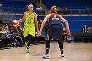 Aerial Powers of the Dallas Wings drives to the basket against the Connecticut Sun during a WNBA preseason game in Arlington, Texas on May 8, 2016.  (Cooper Neill for The New York Times)