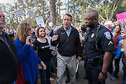 U.S. Rep. Mark Sanford, center, makes his way past constituents after hundreds showed up for a town hall meeting February 18, 2017 in Mount Pleasant, South Carolina. Concerned residents arrived to voice their opposition to President Donald Trump during a vocal meeting.