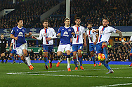 Connor Wickham of Crystal Palace ® clears the ball as Everton press for a goal. Barclays Premier league match, Everton v Crystal Palace at Goodison Park in Liverpool, Merseyside on Monday 7th December 2015.<br /> pic by Chris Stading, Andrew Orchard sports photography.