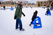 "29 NOVEMBER 2020 - DES MOINES, IOWA: People ice skate at Brenton Skating Plaza in the East Village of Des Moines. Brenton Skating Plaza recently reopened for the season in accordance with Iowa's Coronvirus guidelines. The capacity of the skating rink is one half of normal, skaters have to wear face masks, and they are encouraged to ""social distance"" while they are on the ice.        PHOTO BY JACK KURTZ"