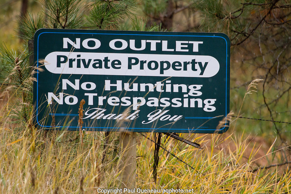 A sign warns the public to keep motorized vehicles out of private land posted No Hunting in Montana.