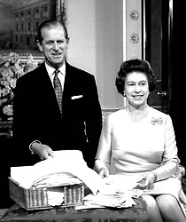 File photo dated 20/11/87 of Queen Elizabeth II and the Duke of Edinburgh in the Belgian suite at Buckingham Palace, with messages of congratulations on their Silver Wedding anniversary. The Royal couple will celebrate their platinum wedding anniversary on November 20.