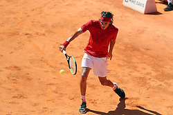 May 4, 2018 - Lisbon, Portugal - Stefanos Tsitsipas of Greece returns a ball to Roberto Carballes Baena of Spain during the Millennium Estoril Open ATP 250 tennis tournament quarterfinals, at the Clube de Tenis do Estoril in Estoril, Portugal on May 4, 2018. (Credit Image: © Pedro Fiuza/NurPhoto via ZUMA Press)