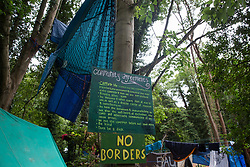 Denham, UK. 13 July, 2020. Denham Protection Camp, which has been created by environmental activists from HS2 Rebellion in order to try to prevent the destruction of woodland for the £106bn HS2 high-speed rail link which will remain a net contributor to CO2 emissions during its projected 120-year lifetime.