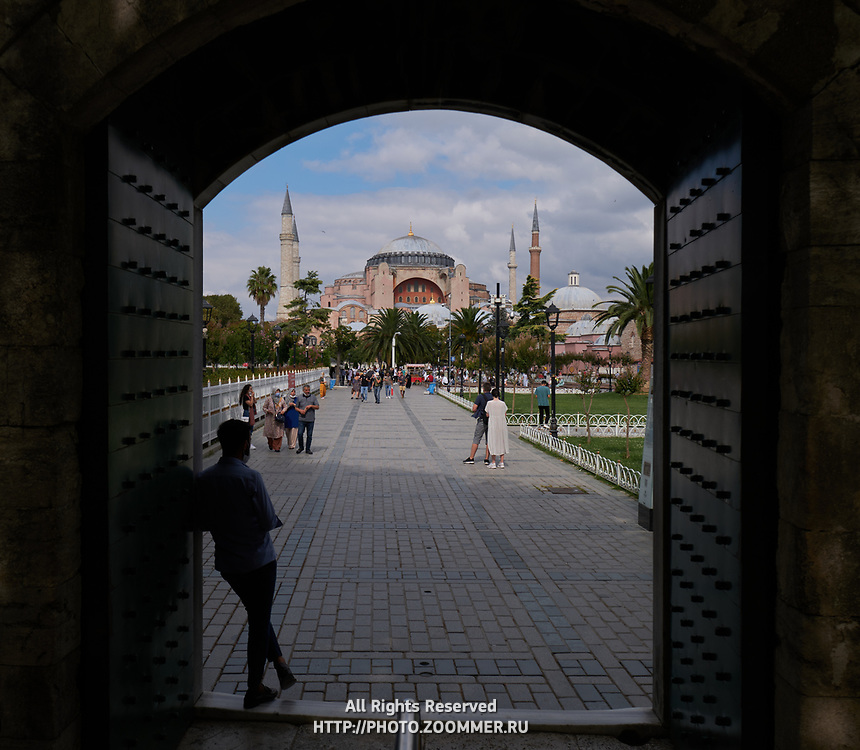 Silhouette of the man in the gate of The Blue Mosque and Hagia Sophia in background, Istanbul, Turkey