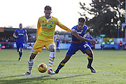 AFC Wimbledon striker Lyle Taylor (33) and Millwall defender Byron Webster (17) during the EFL Sky Bet League 1 match between AFC Wimbledon and Millwall at the Cherry Red Records Stadium, Kingston, England on 2 January 2017. Photo by Stuart Butcher.