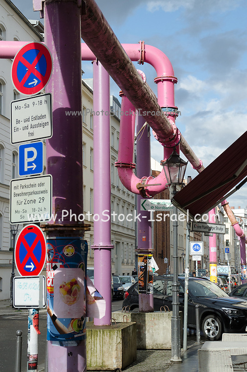 pink overhead drainage pipes. Berlin, Germany