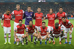 LONDON, ENGLAND - Oct 01:  Arsenal team before the UEFA Champions League match between Arsenal from England and Napoli from Italy played at The Emirates Stadium, on October 01, 2013 in London, England. (Photo by Mitchell Gunn/ESPA)