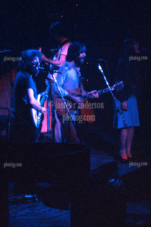 The Grateful Dead perform Live at the  New Haven Coliseum on 5 May 1977. View from Stage Right of Jerry, Bobby, Phil and Donna.