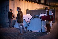 Members of the host network set up tents for migrants that the Red Cross will leave on the street in full curfew. Irun (Basque Country). November 13, 2020.  A group of volunteers has created a host network to serve migrants and inform about the public services they are entitled to and the ways to cross the border. This group of volunteers is avoiding a serious humanitarian problem Irun, the Basque municipality on the border with Hendaye. As the number of migrants arriving on the coasts of southern Spain incresead, more and more migrants are heading north to the border city of Irun. One of the functions performed by these volunteers is to direct the newcomers to the device the red cross has for migrants in transit, so that they can sleep in a safe place. (Gari Garaialde / Bostok Photo)
