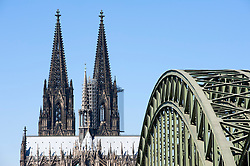 View of Hohenzollern railway bridge crossing  and Cathedral or Dom in Cologne Germany