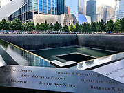 The 9/11 Memorial in New York City with a section of the names of people who were killed in the foreground