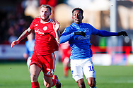 Accrington Stanley defender Callum Johnson (2) and Portsmouth forward Jamal Lowe (10)  during the EFL Sky Bet League 1 match between Accrington Stanley and Portsmouth at the Fraser Eagle Stadium, Accrington, England on 27 October 2018.