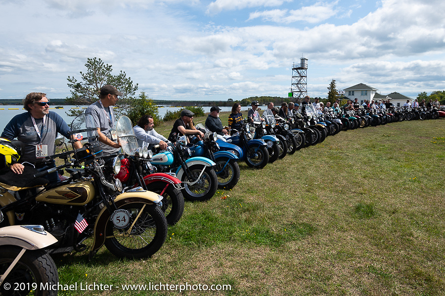 Posing for the panorama portrait in Aune Osborne Park in Sault Sainte Marie, the site of the official start of the Cross Country Chase motorcycle endurance run from Sault Sainte Marie, MI to Key West, FL. (for vintage bikes from 1930-1948). Thursday, September 5, 2019. Photography ©2019 Michael Lichter.