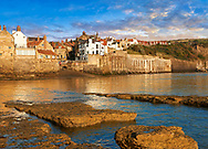 Harbour  of historic fishing village of Robin Hood's Bay, Near Whitby, North Yorkshire, England. .<br /> <br /> Visit our ENGLAND PHOTO COLLECTIONS for more photos to download or buy as wall art prints https://funkystock.photoshelter.com/gallery-collection/Pictures-Images-of-England-Photos-of-English-Historic-Landmark-Sites/C0000SnAAiGINuEQ