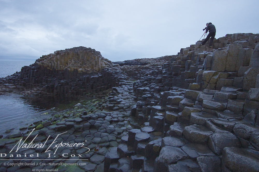 Dave Easton works hard for a photo on a dreary day at Giants Causeway, northern, Ireland.