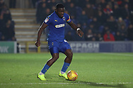 AFC Wimbledon defender Deji Oshilaja (4) dribbling during the EFL Sky Bet League 1 match between AFC Wimbledon and Southend United at the Cherry Red Records Stadium, Kingston, England on 24 November 2018.