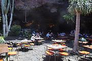 Restuarant cavern formed by volcanic lava tunnel, Jameos de Agua, Lanzarote, Canary Islands, Spain