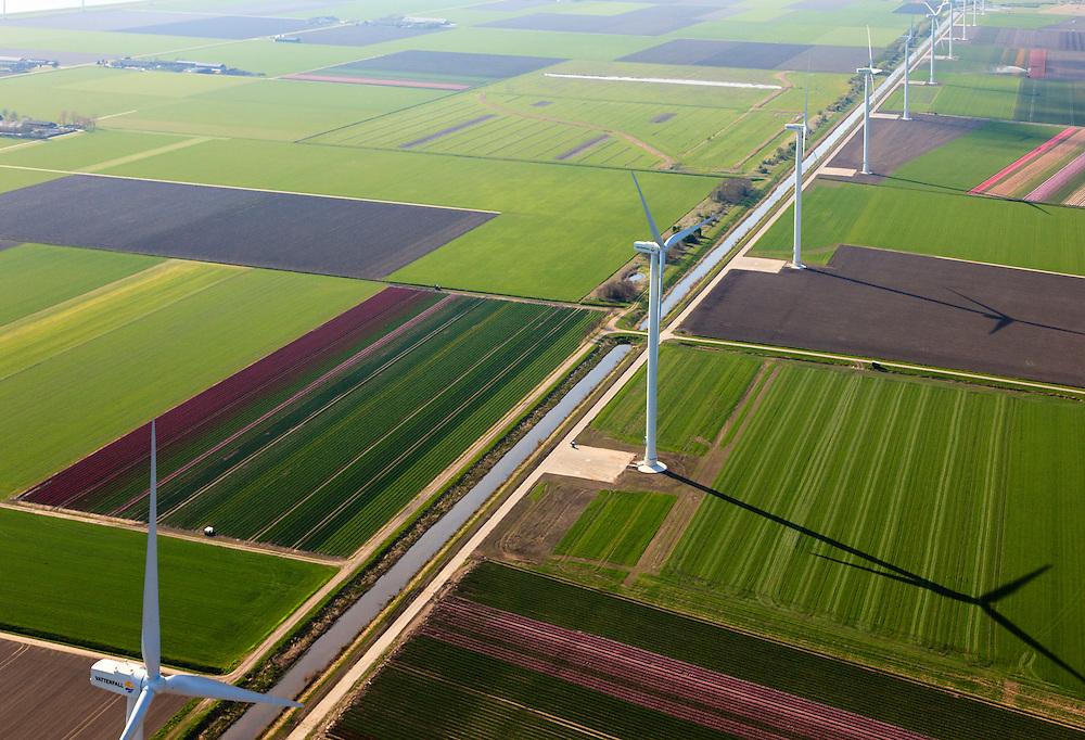 Nederland, Flevoland, Zeewolde, 01-05-2013; Wind farm De Zuidlob. Het windmolenpark (windpark) is een initiatief van  lokale agrariers / boeren en Nuon - Vattenfall. De bollenvelden worden besproeid..The wind farm in the polder Flevoland is an initiative of local farmers and Nuon - Vattenfall. Bulb fields between the windmills..Luchtfoto (toeslag op standard tarieven).aerial photo (additional fee required).copyright foto/photo Siebe Swart