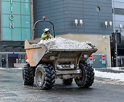 Pictured:Workers on the new St James development in Edinburgh used their equipment to clear snow in the city centre on Thursday morning.<br /> <br /> The severe winter weather continued to cause chaos throughout Scotland, with the most severe level of Amber warning being extended until 10am on Friday 02 March.<br /> <br /> © Dave Johnston / EEm