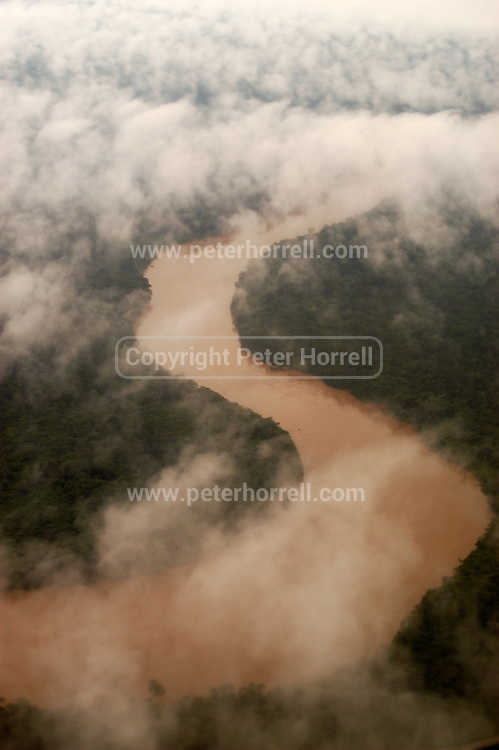 Peru - Saturday, Dec 07 2002: View of a river meandering through the jungle from the aeroplane from Cusco to Puerto Maldonado, Madre de Dios. (Photo by Peter Horrell / http://www.peterhorrell.com)