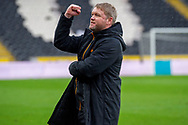 Hull City Manager Grant McCann gestures towards the owners box moments prior to the full time whistle celebrating the league 1 title during the EFL Sky Bet League 1 match between Hull City and Wigan Athletic at the KCOM Stadium, Kingston upon Hull, England on 1 May 2021.