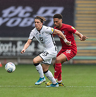 Swansea City's Conor Gallagher (left) under pressure from Bristol City's Zak Vyner (right) <br /> <br /> Photographer David Horton/CameraSport<br /> <br /> The EFL Sky Bet Championship - Swansea City v Bristol City- Saturday 18th July 2020 - Liberty Stadium - Swansea<br /> <br /> World Copyright © 2019 CameraSport. All rights reserved. 43 Linden Ave. Countesthorpe. Leicester. England. LE8 5PG - Tel: +44 (0) 116 277 4147 - admin@camerasport.com - www.camerasport.com