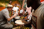 Canadian artist Dave Bidini drums with members of the Liberian Dance Troupe (LDT) at the Buduburam refugee settlement, roughly 20 km west of Accra, Ghana's capital, on Saturday April 14, 2007. One of the main goals of the LDT is to teach young refugee children, many of which have never seen Liberia, about their country's music, dance and culture. The Buduburam refugee settlement is still home over 30,000 Liberians, most of which have mixed feelings about returning to Liberia..