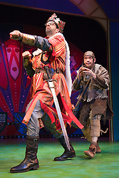 """© Licensed to London News Pictures. 26/07/2012. London, England. Marcus Brigstocke as King Arthur and Todd Carty as Patsy. Monty Python's """"Spamalot"""" musical based on the film """"Monty Python and the Holy Grail"""" opens at the Harold Pinter Theatre in London. The role of King Arthur is shared between Jon Culshaw and Marcus Brigstocke. Photo credit: Bettina Strenske/LNP"""