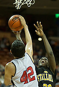Dalyn Mumphrey (33) of Dallas Triple A Academy has his shot blocked by Alfredo Rodriguez (42) of El Paso Harmony Science Academy during the UIL Conference 1A semifinals at the Frank Erwin Center in Austin on Thursday, March 7, 2013. (Cooper Neill/The Dallas Morning News)
