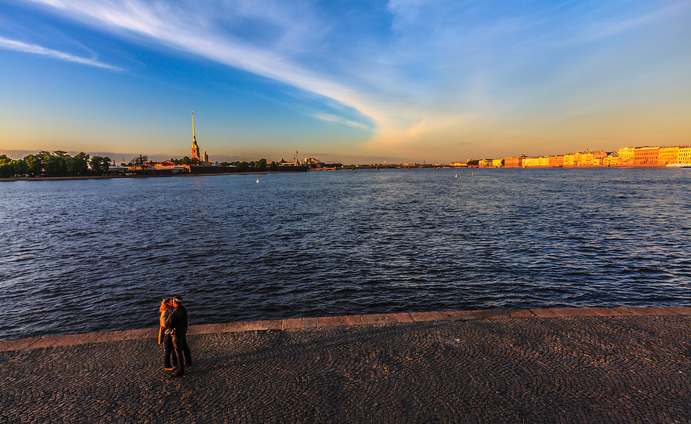 Lovers on the Vasilyevsky Island in St. Petersburg, Russia, The banks ot Neva River are a popular stage for a romance.