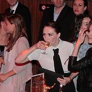 NLD/Amsterdam/20110328 - Uitreking Rembrandt Awards 2011, Carice van Houten neemt even slokje wijn