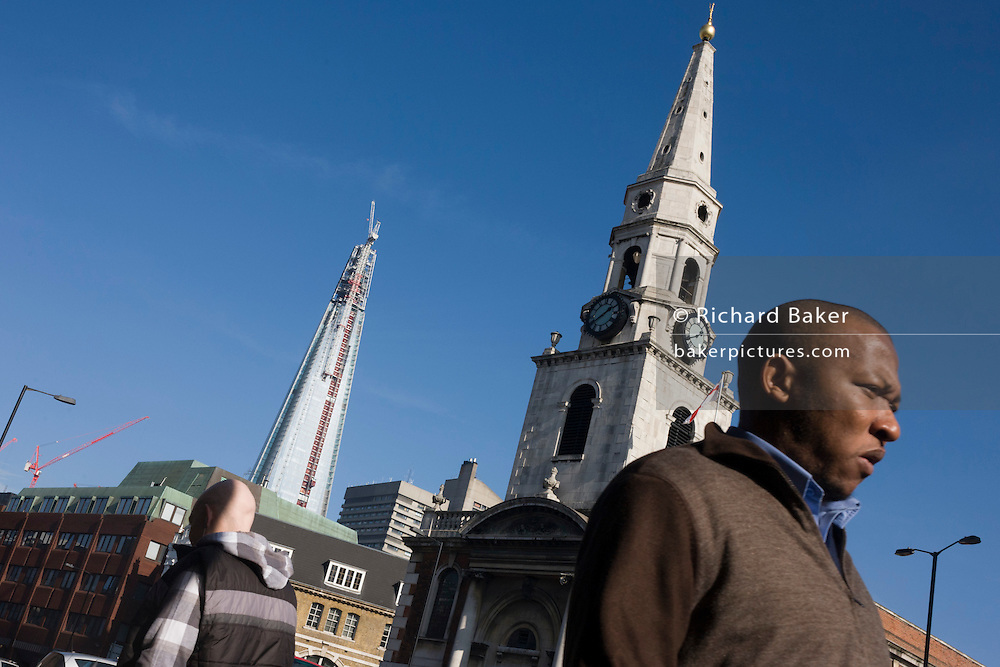 The almost-complete Shard skyscraper is seen alongside the spire of St George the Martyr church at Marshalsea. The Shard is a skyscraper under construction in Southwark, London. Completed in May 2012, it is the tallest building in the European Union and the 46th-tallest building in the world, standing 310 m (1,017 ft) tall. It is also be the second-tallest free-standing structure in the UK. Several Qatari investors finded the construction of the tower via Islamic finance.