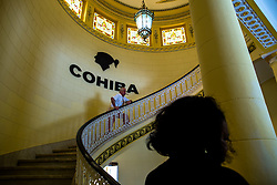 """A visitor poses for photos in front of the Cohiba cigar logo at the """"El Laguito"""" factory in Havana, capital of Cuba, on March 3, 2016. Cohiba is the flagship brand of Cuban cigar. It was first created in 1966 for Cuban revolutionary leader Fidel Castro himself and was then top secret. It soon became Cuban gifts for heads of state and visiting diplomats. Since 1982 Cohiba has been available in limited quantities to the open market. The name """"Cohiba"""" is an ancient Taino Indian word for the bunches of tobacco leaves that Columbus first saw being smoked by the original inhabitants of Cuba. EXPA Pictures © 2016, PhotoCredit: EXPA/ Photoshot/ Liu Bin<br /><br />*****ATTENTION - for AUT, SLO, CRO, SRB, BIH, MAZ only*****"""