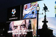 A government NHS (National Heath Service) ad displays the face of a Covid patient, urging Londoners to stay at home and not to take risks or bend the rules during the third lockdown of the Coronavirus pandemic, at Piccadilly Circus in the capital's West End, on 5th February 2021, in London, England.