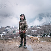 Sonam, daughter, 9 years old. Life at Mr and Ms Wangchuk's house on the edge of the Laya village.