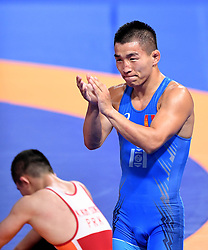 JAKARTA, Aug. 19, 2018  Bekhbayar Erdenebat of Mongolia celebrates after winning the gold medal of Men's Wrestling Freestyle 57 kg Final against Kang Kum Song of the Democratic People's Republic of Korea in the 18th Asian Games in Jakarta, Indonesia, Aug. 19, 2018. Erdenebat won 8-2. (Credit Image: © Yue Yuewei/Xinhua via ZUMA Wire)