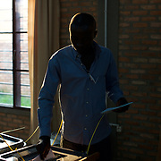A local man casts the last vote for the parliamentary elections at a polling station near Musaga neighbourhood, Bujumbura, June 29, 2015.