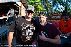 Michael Lichter and Darwyn Jones at the Iron Horse Saloon during Daytona Bike Week. Ormond Beach, FL. USA. Monday March 12, 2018. Photography ©2018 Michael Lichter.