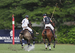 Prince Harry (left) takes part in the Sentebale Royal Salute Polo Cup at the Singapore Polo Club.