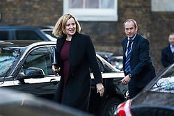 © Licensed to London News Pictures. 19/12/2017. London, UK. Home Secretary Amber Rudd (L) arrives on Downing Street for the weekly Cabinet meeting. Photo credit: Rob Pinney/LNP
