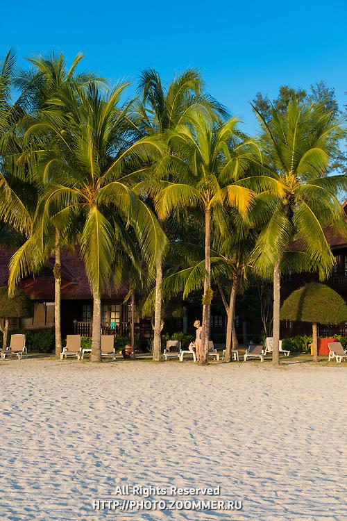 Meritus Pelangi hotel and palm trees at Cenang beach, Langkawi, Malaysia