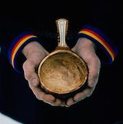 A Sami man holding hand made bowl, Lapland, Sweden