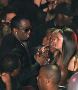 """**EXCLUSIVE**.Sean P. Diddy Combs with a girl.Vibe Magazine and Ciroc Present Sean """"Diddy"""" Combs """"Press Play"""" Album Release Party ñ Inside.Crobar Nightclub.New York City, NY, USA .Monday, October 16, 2006.Photo By Celebrityvibe.com.To license this image call (212) 410 5354 or;.Email: celebrityvibe@gmail.com; .Website: http://www.celebrityvibe.com/. ...."""