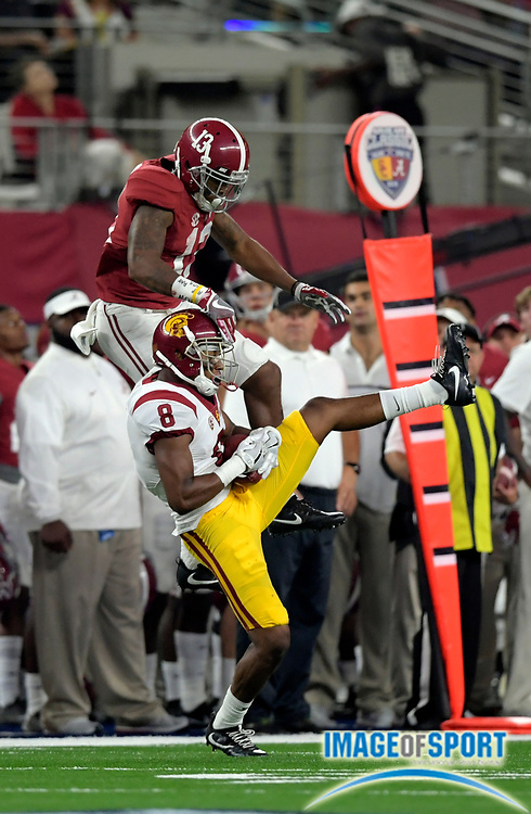 Sep 3, 2016; Arlington, TX, USA; USC Trojans defensive back Iman Marshall (8) intercepts the ball in front of Alabama Crimson Tide wide receiver ArDarius Stewart (13) during the third quarter at AT&T Stadium.