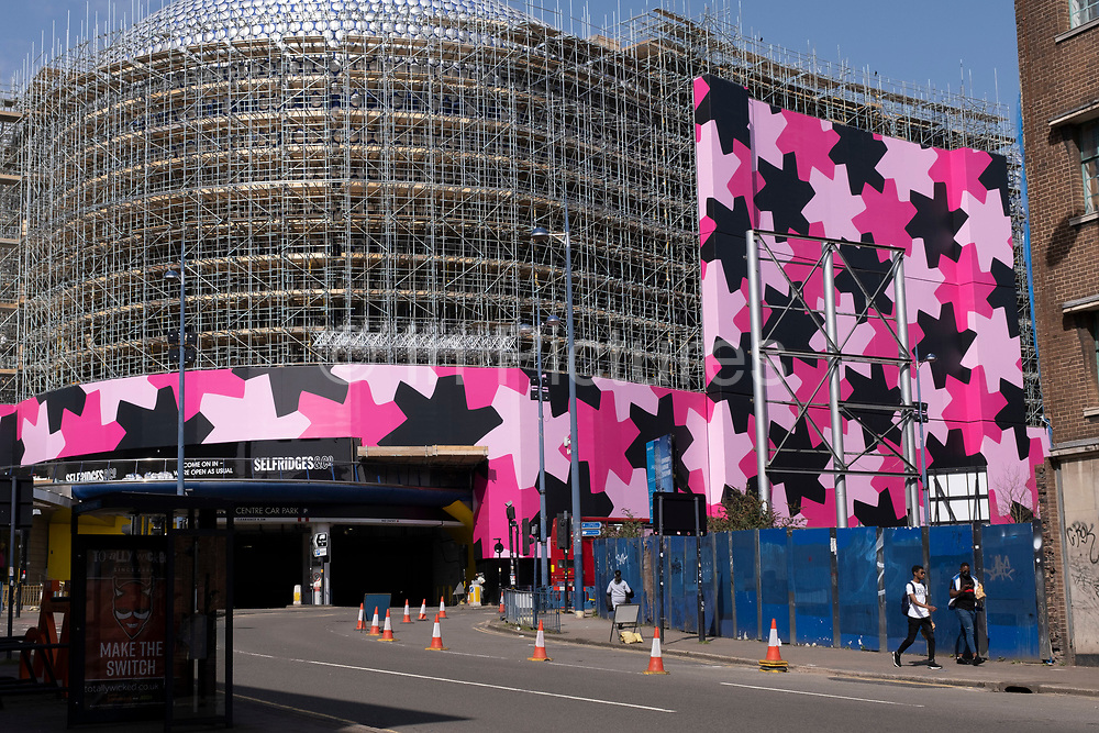 Refurbishment of the iconic Selfridges building in the city centre on 31st March 2021 in Birmingham, United Kingdom. The exterior of the building will be wrapped in scaffolding and a pink protective covering while it undergoes renovation while the discs are cleaned and repainted in its original colour.