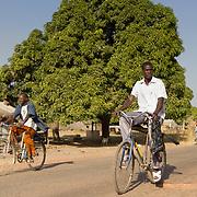 Riding to Koumbadiouma's Sunday market. Kolda, Senegal.